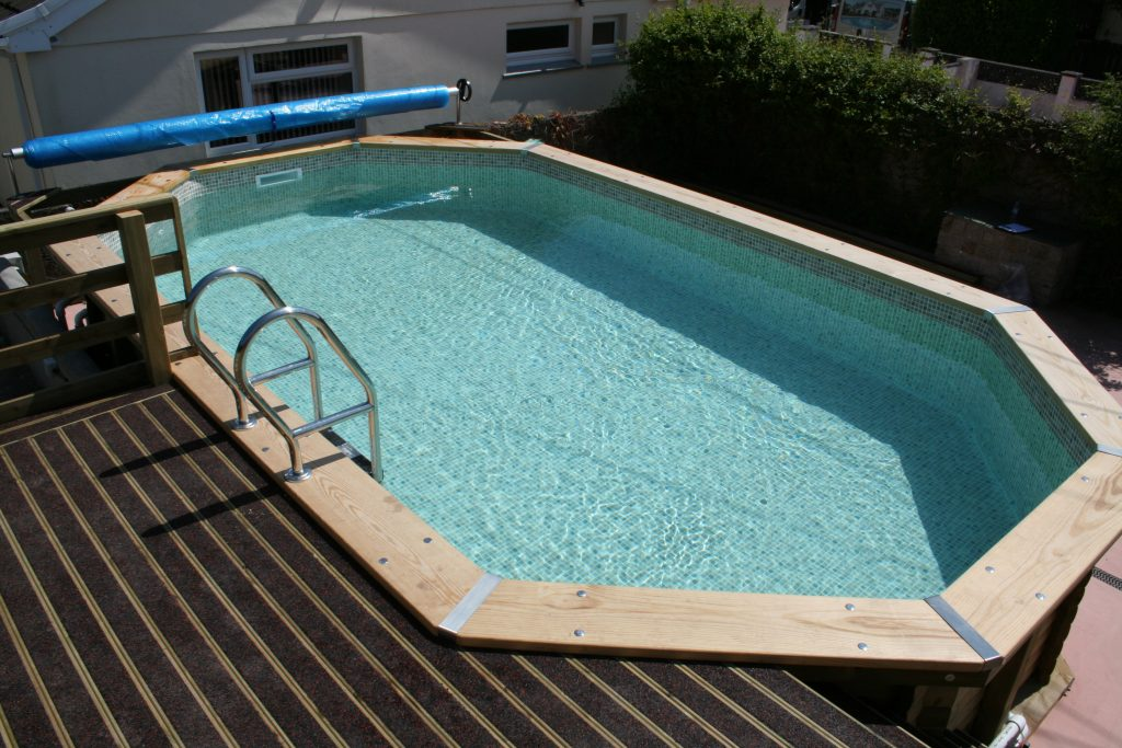 Wooden swimming pool with decking